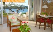 The-living-room-and-patio-of-a-1-bedroom-villa-with-view-over-San-San-Bay