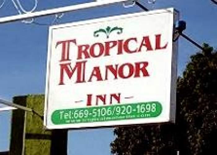 Tropical Manor Inn logo